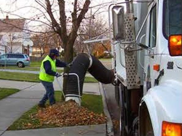 Beachwood Service Employee Using Leaf Vac to Pick Up Leaves