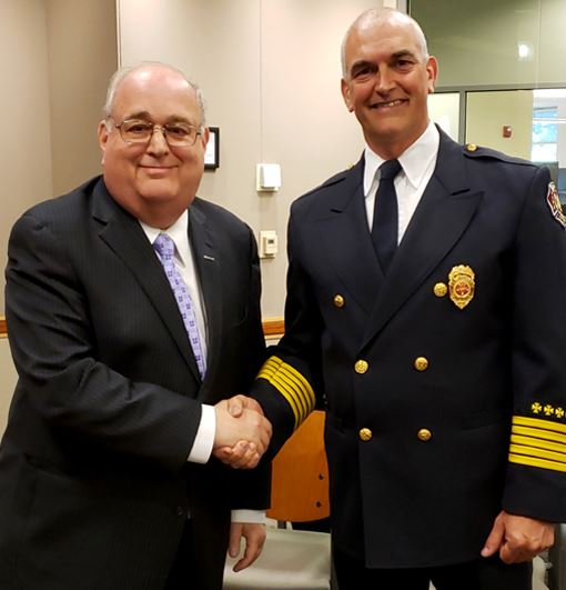 Mayor Horwitz and Fire Chief Holtzman shake hands after the Chief was sworn in.