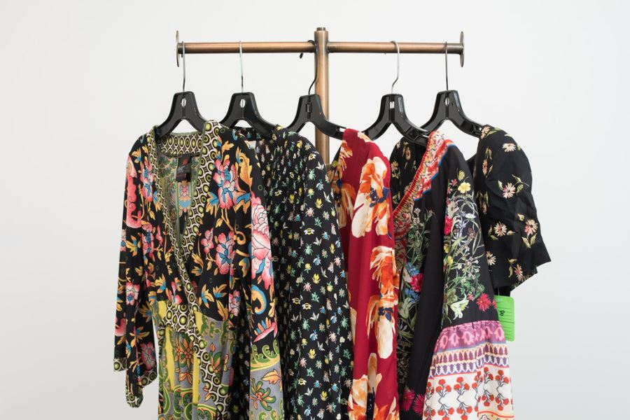 pretty floral dresses hanging on a rod