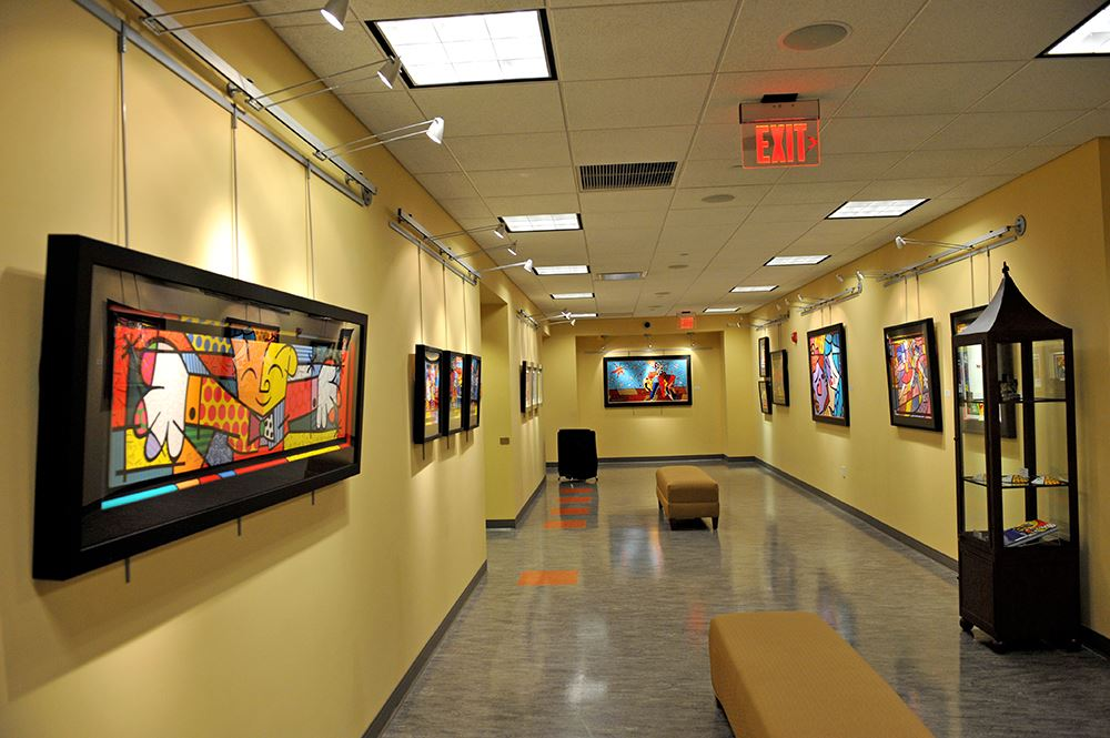 Art Gallery installation of brightly colored paintings
